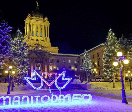 Daniel Crump / Winnipeg Free Press. The Manitoba Legislature is lit up to celebrate Manitoba 150 on Saturday evening. December 14, 2019.